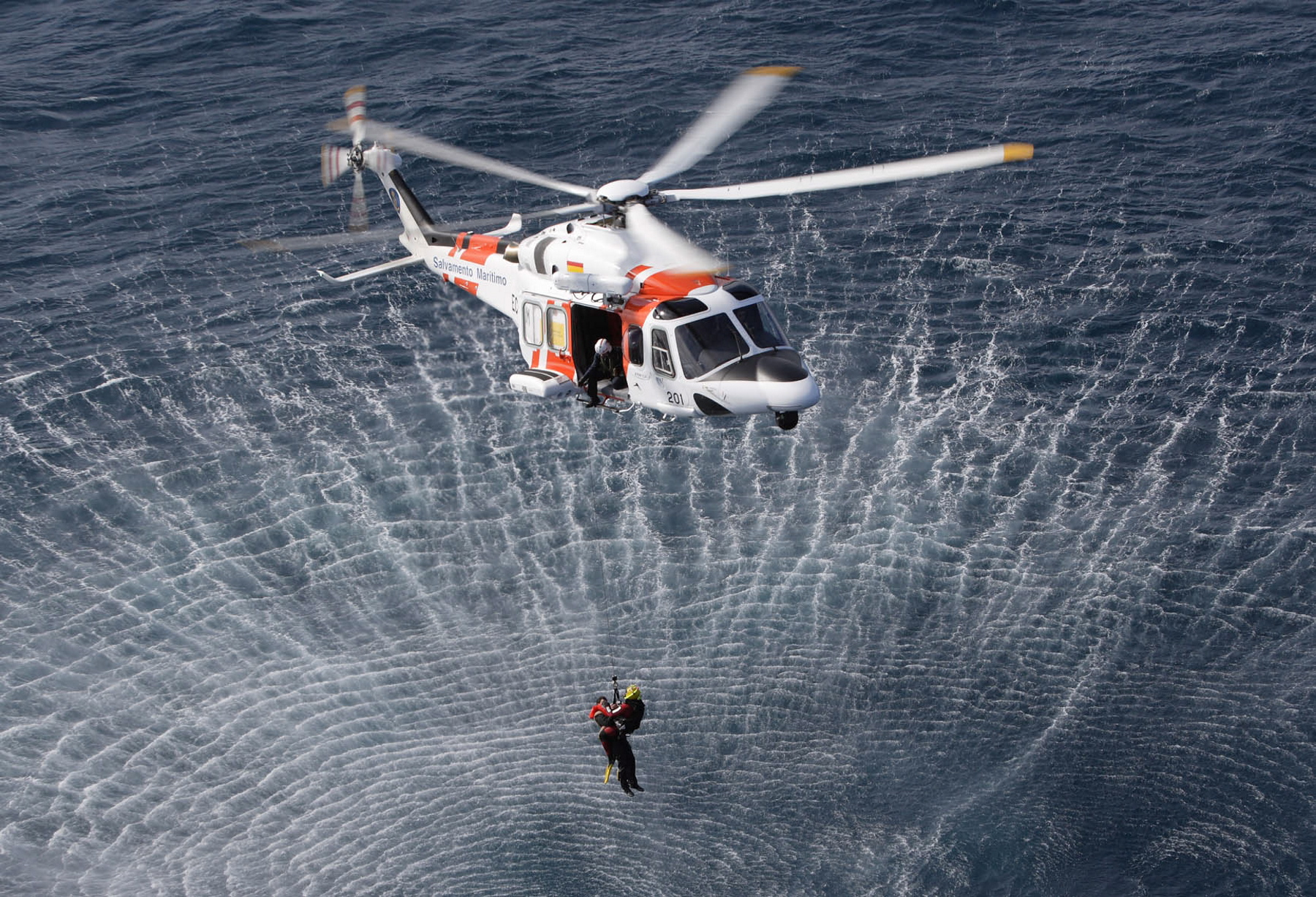 Helicopter rescusing someone from sea