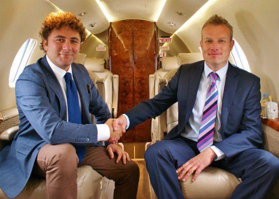 Daniele of Blu Halkin shakes hands with Jon of Cambridge airport