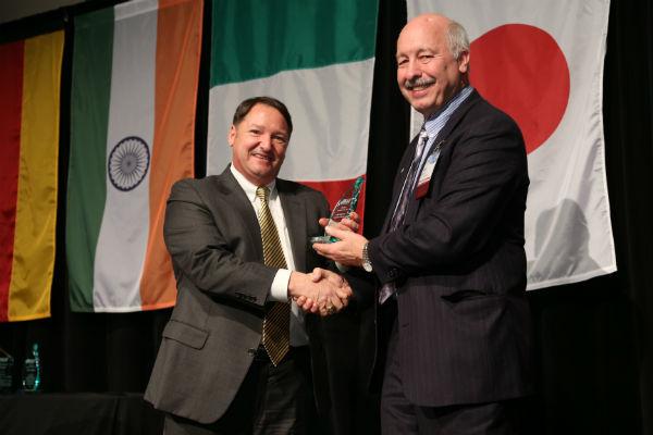 Jon Buccola (left) receives his award from John Graham, PNAA Secretary and Board Member