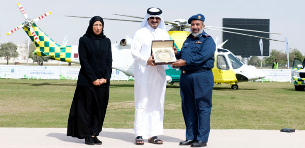 Dr Hanan Al Kuwari (left) with HE Abdulla Khalid Al Qahtani, Minister for Health and Major General Ghanim bin Shaheen Al Ghanim in front of one of the new AW139 helicopters